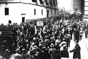 Crowd of people in the streets during the stock market crash of 1929.