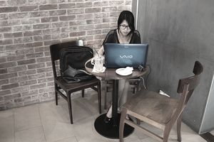 Woman on computer in coffee shop