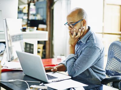 Businessman working on project on laptop in office