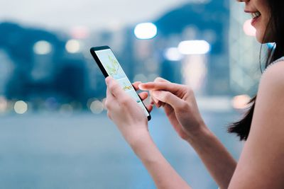 woman checking stocks on her smartphone