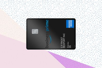 The face of an Amazon Business Prime American Express credit card on a tri-color field of pink, mauve, and blue swoops, meeting blue confetti.