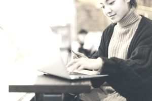 Young woman using credit card and laptop