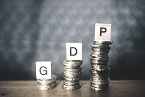 The letters GDP stand atop stacks of coins with increasing height