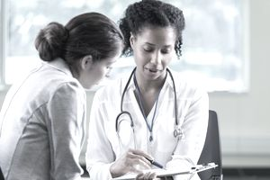 Doctor reviews a patient's medical information