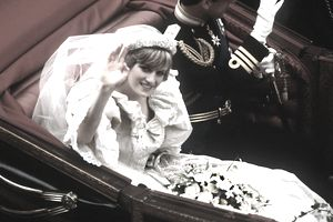 Princess Di riding in carriage on wedding day