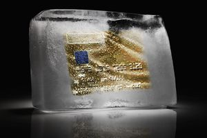 Credit card frozen inside a block of ice