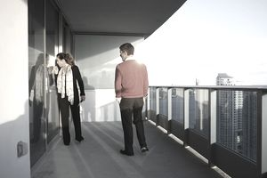 Couple standing on hi-rise balcony looking inside through glass doors