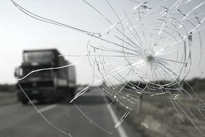 Cracked windshield on highway as truck approaches