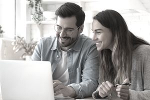 Couple doing taxes at home on laptop