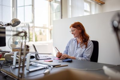 Woman having teleconference at her desk