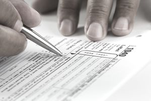 Man filling out his tax paperwork