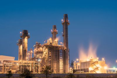 Natural gas-fired electric power plant lit up at night.