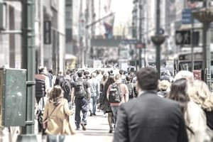 USA, New York, Manhattan streets. Skyscrapers and crowded streets, cars and busy people walking downtown in a spring sunny day