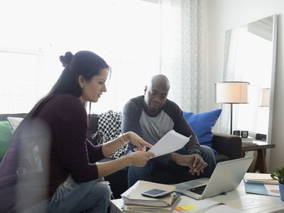 Couple reviewing the Cash Surrender Value of Life Insurance