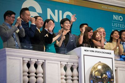 Excited people celebrate at the opening bell of NYSE