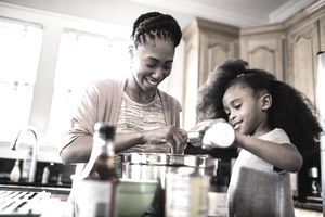 Mother and daughter cooking together at home