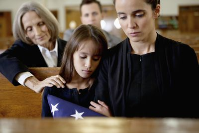 Mother and daughter at a funeral
