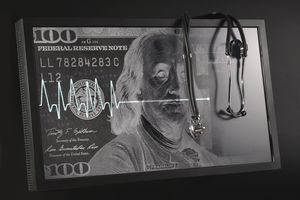 Flatline cardiogram and stethoscope over background of a $100 bill, representing the assets of a deceased individual
