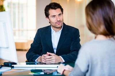 Man talking to financial advisor about an inherited 401(k)