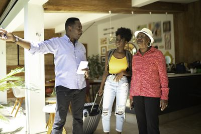Host welcomes vacationing mother and daughter at hotel