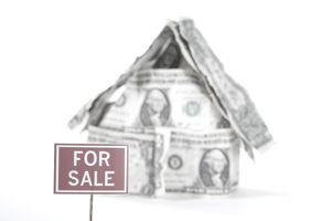 for sale sign in front of house made of dollar bills