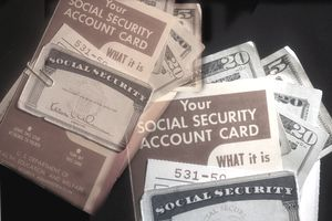 Social Security cards and account statements against a black background