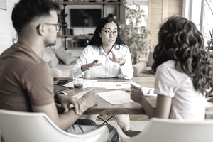 Couple getting advice in a meeting at home with a mortgage lender