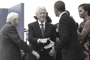 US President Barack Obama (2nd-R) shakes hands with former US President Bill Clinton (2nd-L), as first lady Michelle Obama (R) and former US President Jimmy Carter look on during the 'Let Freedom Ring' commemoration event August 28, 2013 in Washington, DC.