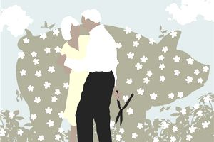 Senior couple dancing near blooming hedge shaped like pig