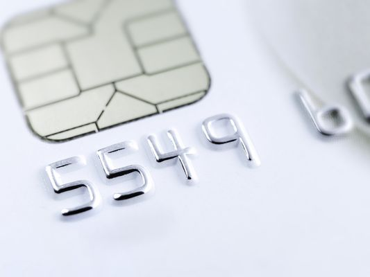 Micro close up of credit card numbers and credit card chip