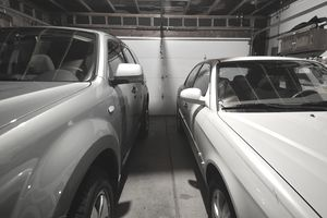 A residential garage with two cars where the owner is getting a multi-car discount.