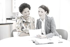 Woman reviewing loan application with loan officer
