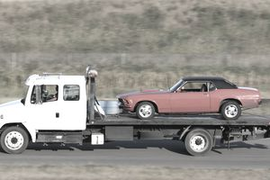 Repossessed car being towed