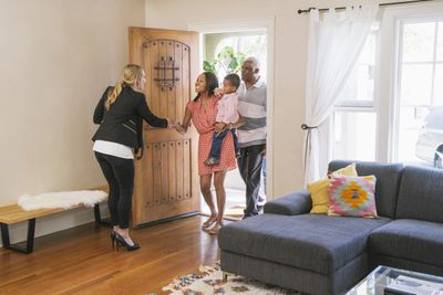 Real estate agent showing house to clients