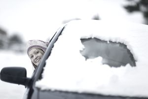 A woman driving in the snow
