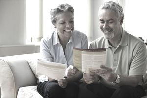 Couple reviewing insurance booklet