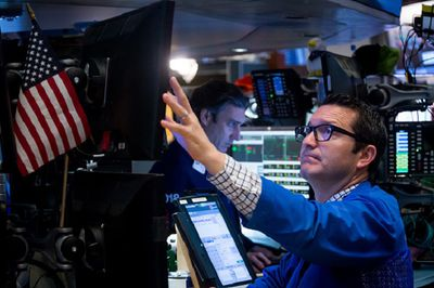 Broker trading on the floor of the NYSE