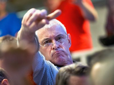 Unhappy trader on Black Monday in the trading pits of an exchange.