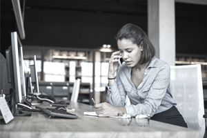 Person on a cell phone listening to a phone scam