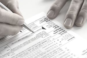 Woman signing tax form