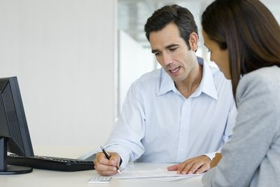 Financial Advisor and client going over fanancial statements in an office