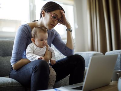 Tired young mother working from home