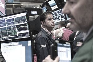 Traders working on trading derivatives markets on the floor of the New York Stock Exchange