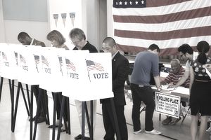 People casting paper ballots at a voting station