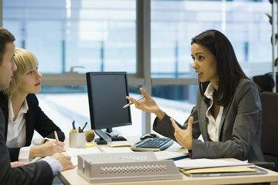 female banker talking to couple