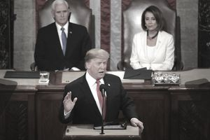 President Donald Trump delivers the 2019 State of the Union outlining federal budget expenditures with Speaker Pelosi and Vice President Pence looking on.