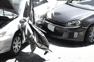 Two car collision with damage to both cars