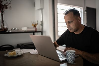 Man sitting and working on a laptop