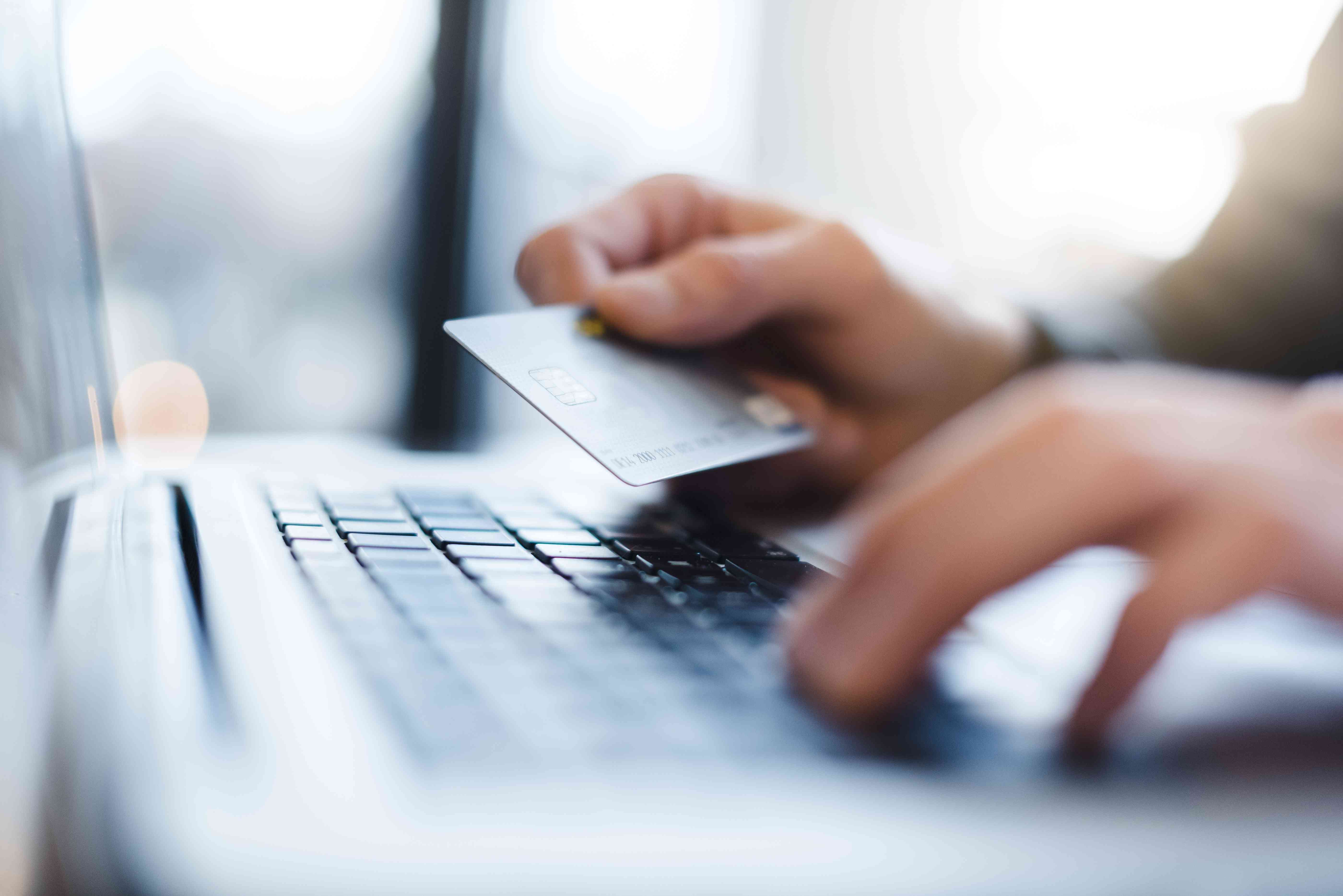 Man using credit card to setup a auto billing subscription service