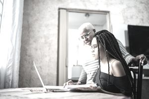 Mother and daughter looking at a laptop at home